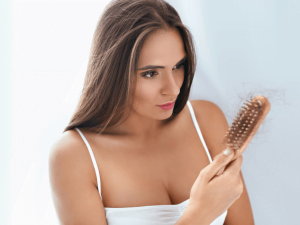 lady hair in brush