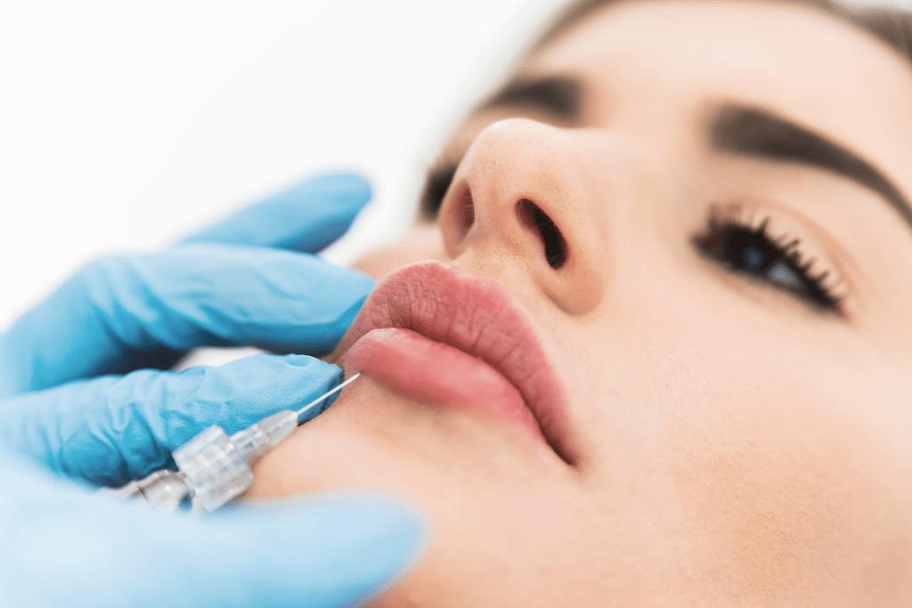 woman taking lip injection
