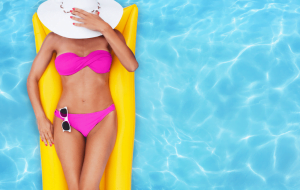 woman relaxing in the pool hiding her face