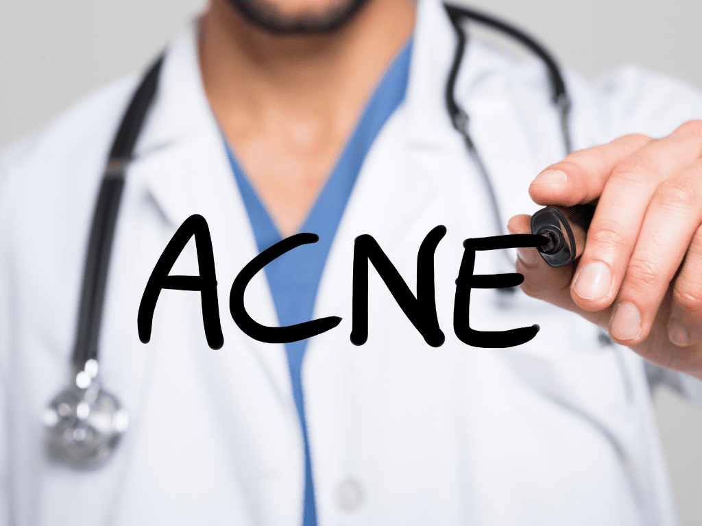 doctor writing acne
